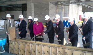 St. Louis County Executive Charlie A. Dooley and the County Council Chair Hazel Erby along with project team members pour concrete at the Family Courts Groundbreaking on May 13, 2014.